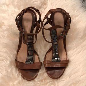 Tan and gunmetal heeled wedges